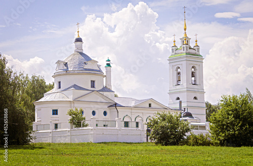 Fotografie, Obraz Orthodox Church on a summer day against the background of a blue sky with clouds