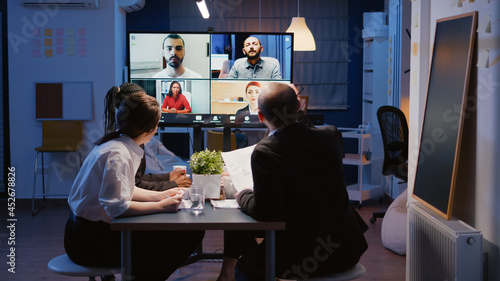 Fotografering Multi ethnic businesspeople brainstorming company ideas during online videocall conference meeting discussing with remote teamwork