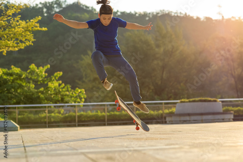 Skateboarder skateboarding outdoors in city