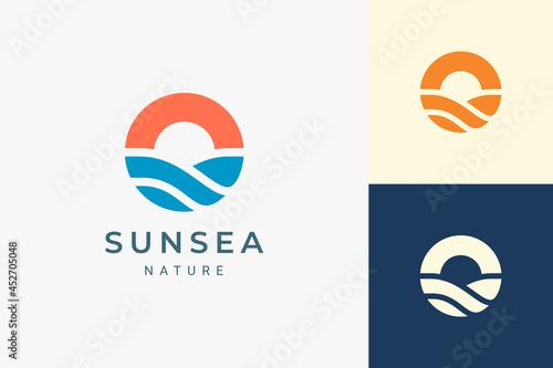 Beach or coast logo in simple sun and ocean shape Fotobehang