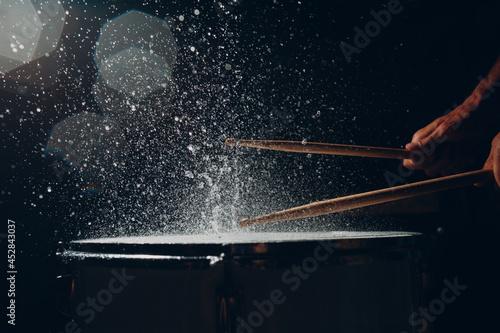 Fényképezés Close up drum sticks drumming hit beat rhythm on drum surface with splash water