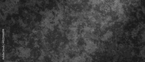 Abstract background in black and gray colors with shaded edges. Marbled noisy texture.