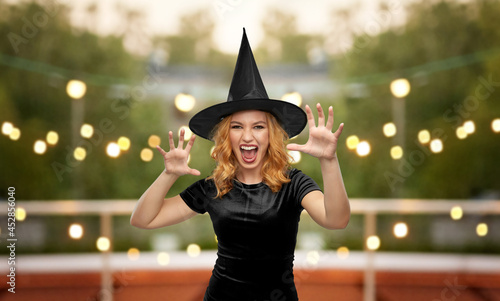 Fényképezés holiday and black magic concept - scary woman in halloween costume of witch conj