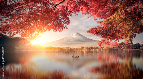 Canvas Colorful Autumn Season and Mountain Fuji with morning fog and red leaves at lake