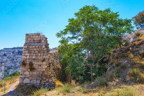Fotografie, Obraz Jerusalem, Israel - June 25, 2021: Ruins of Crusader structures in a burial area