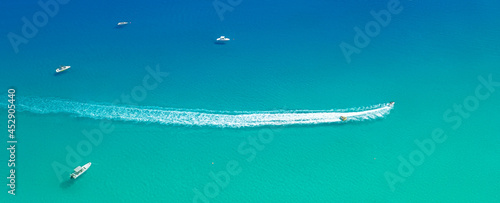 Fotografie, Obraz Speed boat with slider leave trail on water, sea panorama from above