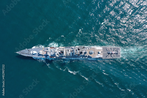 Foto Aerial view of naval ship, battle ship, warship, Military ship resilient and armed with weapon systems, though armament on troop transports