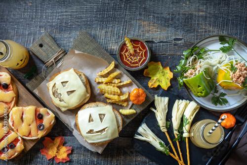 Fotografie, Obraz Halloween party food corner table scene over a wood background