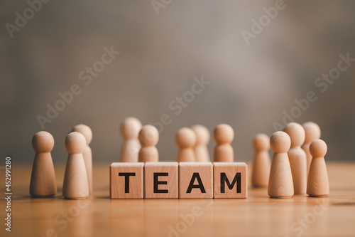 Murais de parede wooden doll that Different and standing with TEAM