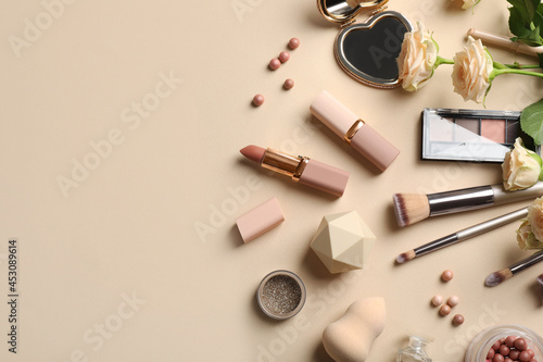 Canvas Flat lay composition with makeup products and beautiful roses on beige backgroun