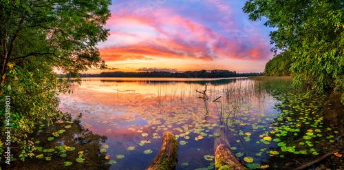 Obraz na plátně Beautiful summer sunrise over lake - Panorama