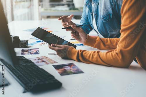 Tela Advertising agency designer creative start-up team discussing ideas in office