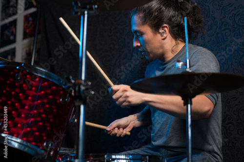 Fotografia, Obraz Young drummer playing his instrument. musical composition