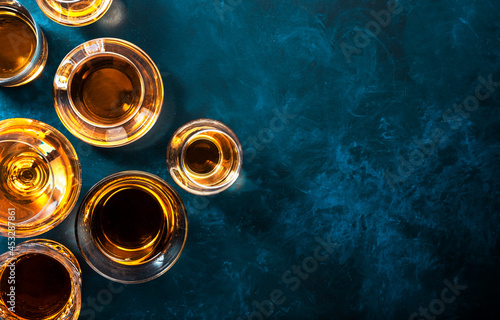 Fotografering Strong alcohol drinks, hard liquors, spirits and distillates iset in glasses: cognac, scotch, whiskey and other