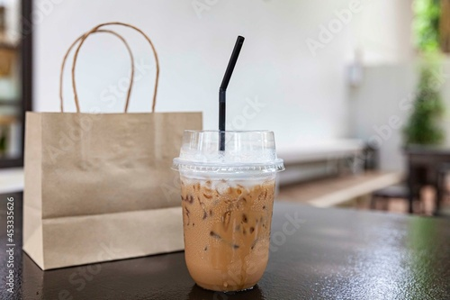 Iced cappuccino in a plastic take-out cup Fototapeta