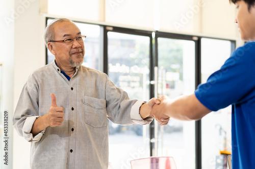 Canvas Salesman office worker with senior elderly customer at auto car repair shop