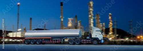Fotografie, Obraz Gasoline oil tanker with fuel tanker truck shipping petroleum refinery is logistic transportation industry oil truck refinery cargo