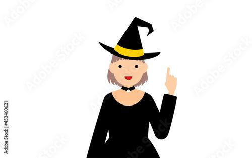 ハロウィンの仮装、魔女姿の女の子が指さしをするポーズ Fototapet