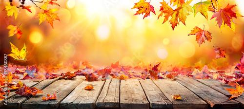 Valokuva Fall Table - Autumn Leaves Falling On Wooden Plank