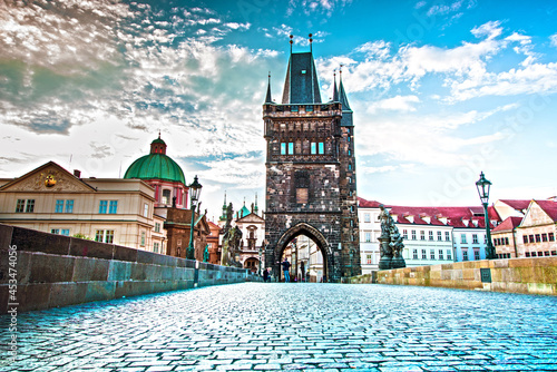 Canvas fascinating mystical landscape with Charles Bridge in an old city in Prague, Czech Republic at dawn