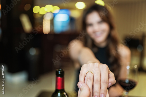 Obraz na płótnie Boyfriend requesting his girlfriend's hand with an engagement ring at a restaura