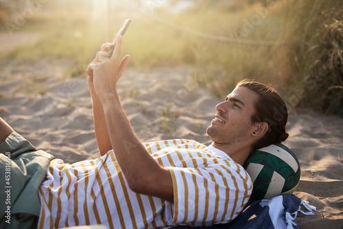 Fotografija Handsome guy chilling at the beach