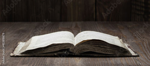 Obraz na płótnie Image of an old  Holy Bible on wooden background on a wooden background in a dar
