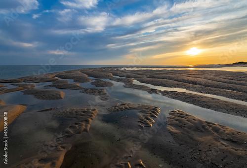 Fototapeta Wattenmeer Sylt Sonnenuntergang Strand Sand Priel Gezeiten Ebbe Deutschland Himm
