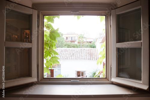 Fototapeta View of courtyard through window