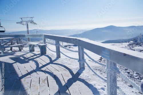 An observation deck in the mountains. Snow-capped mountains. Fototapeta