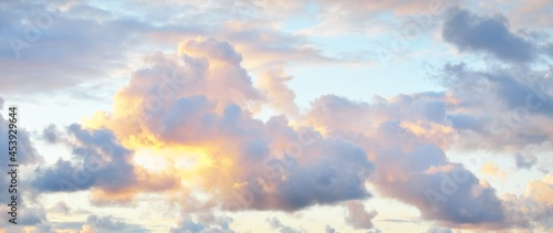 Fotografie, Obraz Clear sky with glowing pink cumulus clouds above the Baltic sea shore after thunderstorm at sunset