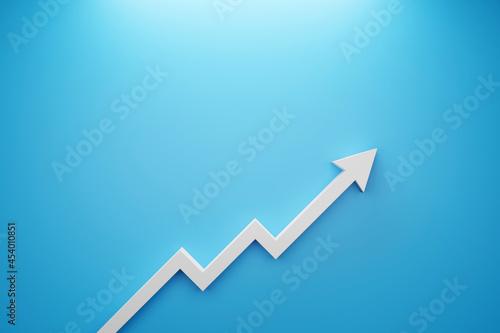 Obraz na plátně Arrow sign growth on blue background