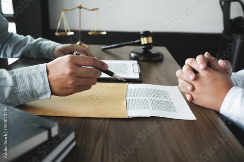 Obraz na plátně Legal counsel presents to the client a signed contract with gavel and legal law