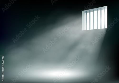 Fototapeta Rays of light through the metal prison bars.
