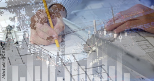 Different graphs, hands drawing and holding a tablet, and a building in construction