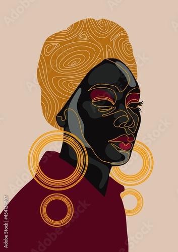 Obraz na plátně Woman wearing turban and hoop earrings