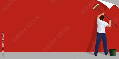 Fond uni pour une présentation commerciale avec un homme qui colle une affiche publicitaire rouge sur un mur de béton Fototapeta