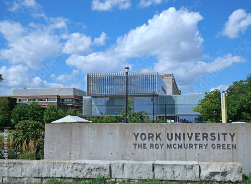 Fototapeta premium Toronto, Canada - View of York University campus from the south, with student center building and stone monument with sign.