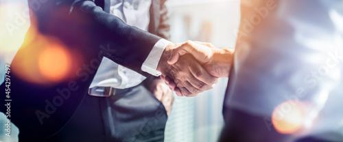 Obraz na plátně Businessman handshake for teamwork of business merger and acquisition,successful