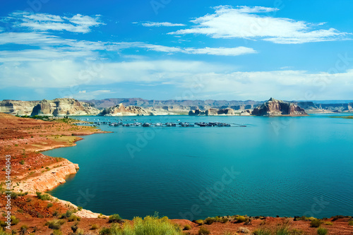Photographie View on tranquil lake with dry arid landscape against blue summer sky with cloud