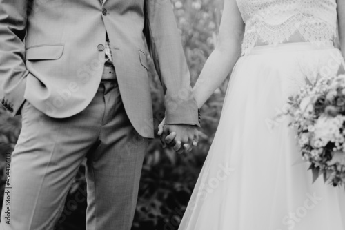 Bride and groom in love holding hands close-up Fotobehang