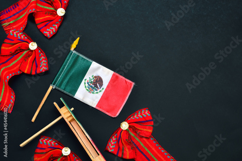 Canvastavla Mexican flag on black background with folklore decoration