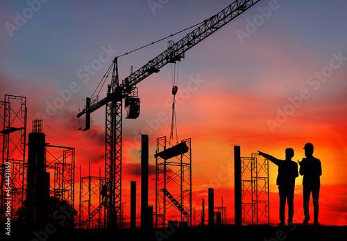Billede på lærred Silhouette engineer standing orders for construction crews and Excavator and mac