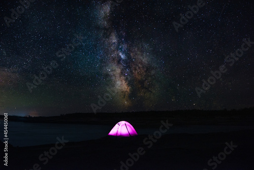 Scenery of milkyway at the middle of the night over Fototapeta