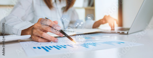 Canvas Close up of Business woman accountant or financial expert coins double exposure analyze business report graph finance chart corporate finance economy banking business stock market research concept