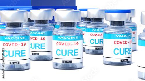 Billede på lærred Covid cure - vaccine bottles with an English label Cure that symbolize a big hum