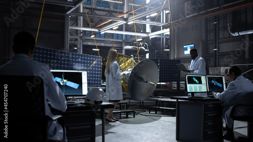 Fotografiet Engineer and Technician Working on Satellite Construction