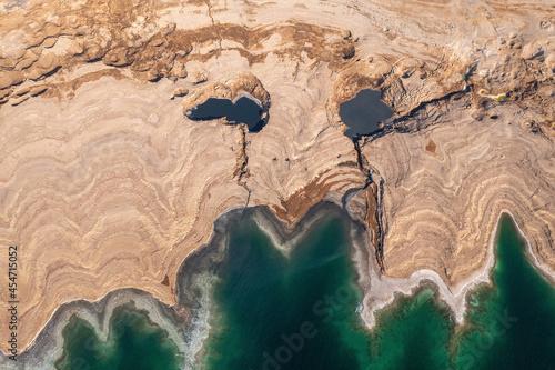 Obraz na plátně Sinkholes in The Dead Sea coastline, Aerial view.
