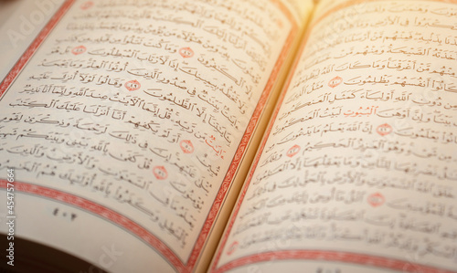 Fotografiet Quran (Koran) - close up of holy book of Muslims, with shining light