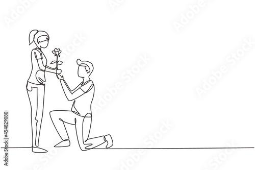 Obraz na płótnie Single one line drawing man on knee gives flowers to woman